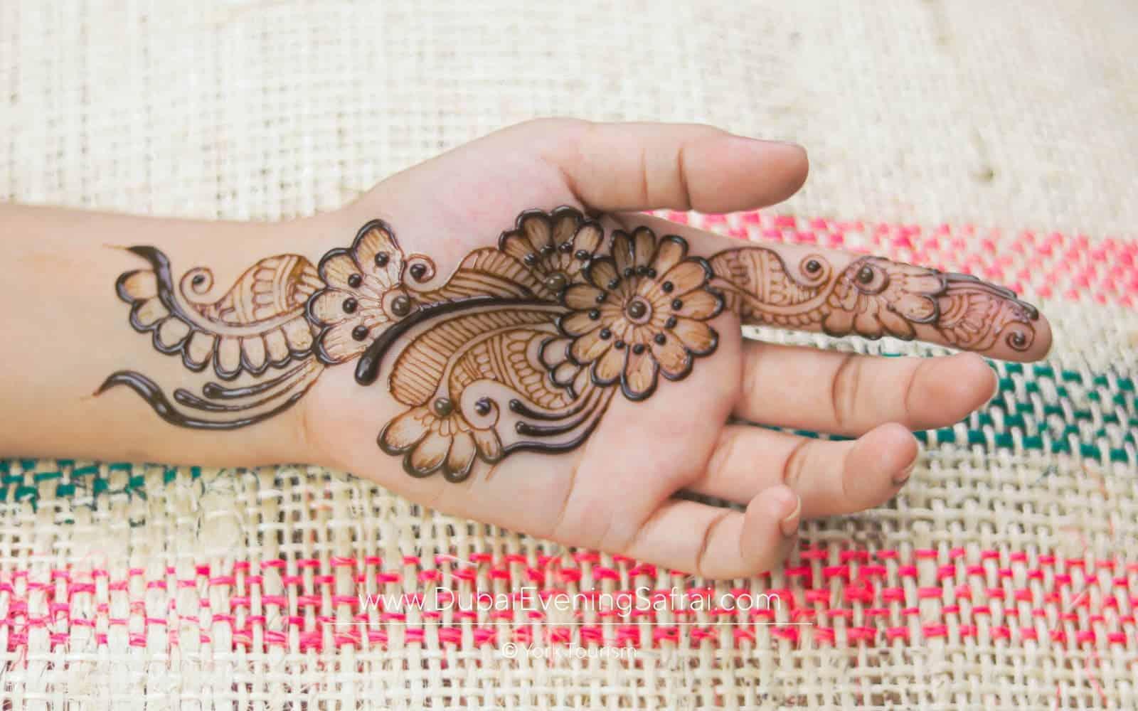 henna art in desert safari
